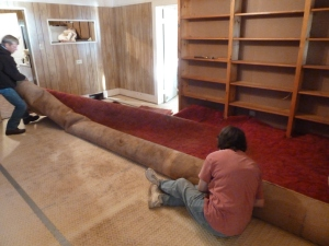 Ed and Barb - Rip up and haul away old carpet. Then pull every carpet tack out of the floor.